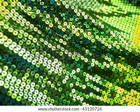 Colorful green sequins. More of this motif & more sequins in my port. - stock photo