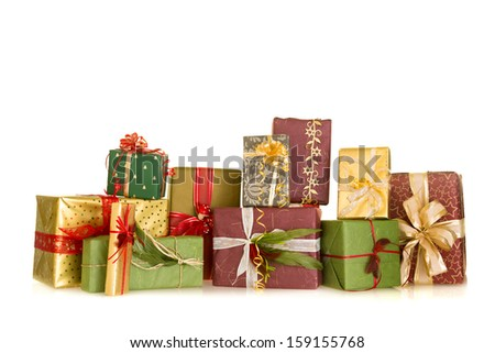 Colorful group of christmas presents decorated with ribbons and feathers - stock photo