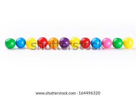 Colorful gumballs border over white background - stock photo