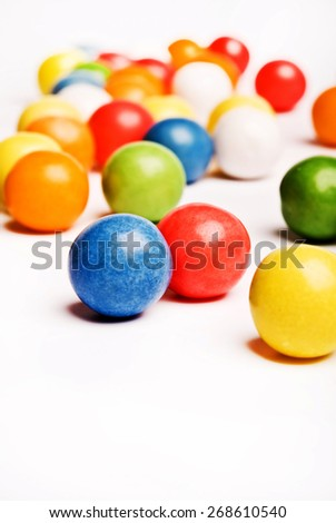 colorful gumballs on a white background