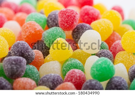 Colorful gumdrops covered in sugar - stock photo