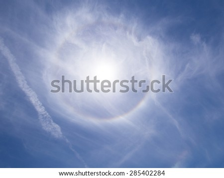 Colorful halo around the Sun - stock photo