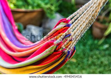colorful hammock stretched between trees in a garden ruta de las flores el salvador colorful hammock stretched between trees garden stock photo      rh   shutterstock
