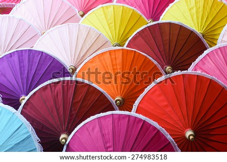 Colorful hand made umbrella - stock photo