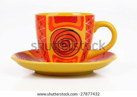 colorful hand-painted coffee cup on a white background - stock photo