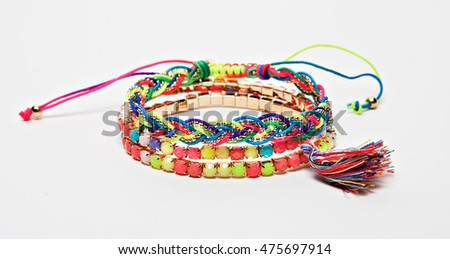 colorful handmade bracelet isolated with shadows