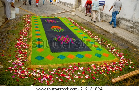 colorful handmade easter carpets made from colored sawdust fruits and flowers in antigua guatemala - stock photo
