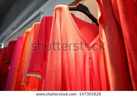 Colorful hanging clothes - stock photo