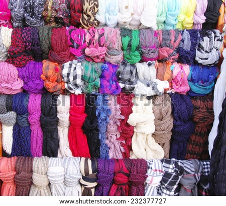 Colorful hanging scarves in shop closeup