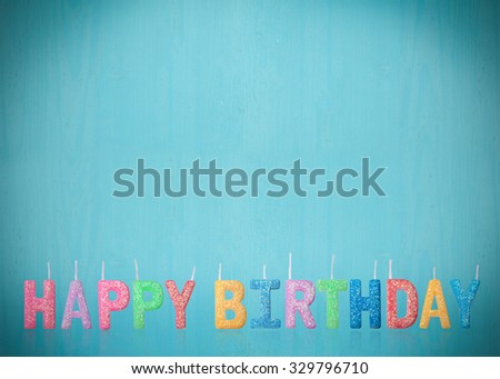 Colorful happy birthday candles with blue vintage background. - stock photo
