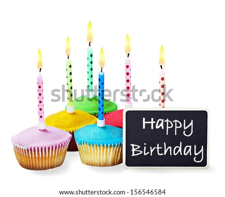 colorful happy birthday cupcakes with candles with compliments - stock photo