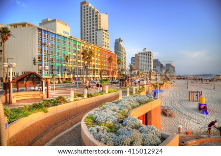 Colorful HDR image of Tel Aviv beach with some of its famous hotels (Mediterranean sea. Israel)   - stock photo