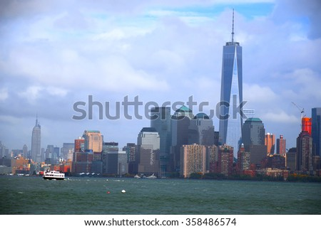 Colorful HDR image of the buildings and skyscrapers in southern Manhattan as seen from the Hudson river - stock photo