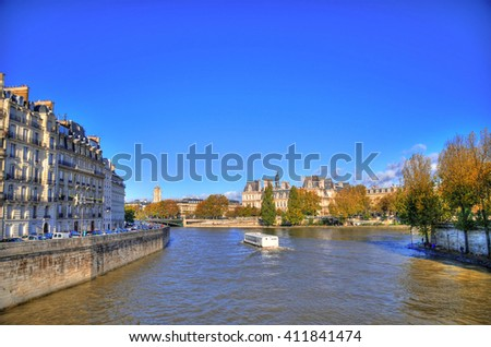 Colorful HDR image the Seine River in Paris with buildings and trees., one of the famous symbols of Paris on clear blue sky - stock photo