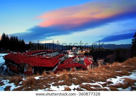 colorful HDR sunset over the winter resort of Pamporovo, bulgarian Rhodope mountains  - stock photo