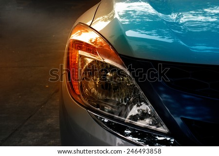 colorful headlights of city car - stock photo