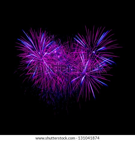 Colorful heart fireworks on the black sky background - stock photo