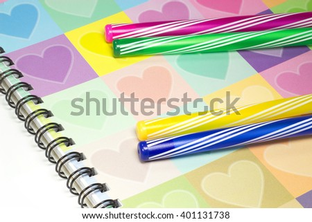Colorful heart graphic cover notebook, diary with colorful pen for business concept