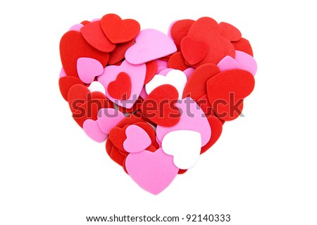 Colorful heart made of Valentines Day heart-shaped confetti - stock photo