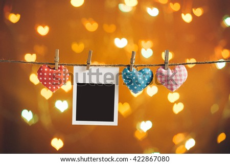 Colorful hearts hanging on clothesline with blank card. Copy space. Image of Valentines day. - stock photo