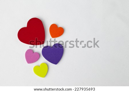 Colorful hearts on bright white background.  Plenty of room for text.