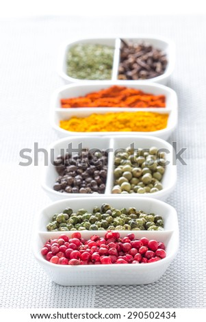 Colorful herbs,spices and aromatic ingredients on modern table. - stock photo