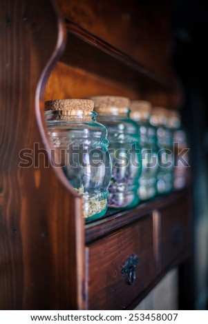 Colorful herbs,spices and aromatic ingredients on wooden shelf. Shallow depth of field.