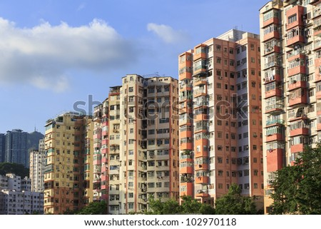 Colorful high-rise residential buildings in Hong Kong - stock photo