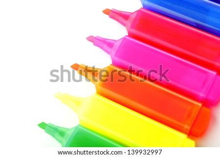Colorful highlighter text markers isolated on white, shallow focus.