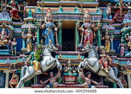 colorful Hindu temple full of sculptures in the Indian district of Kuala Lumpur - stock photo
