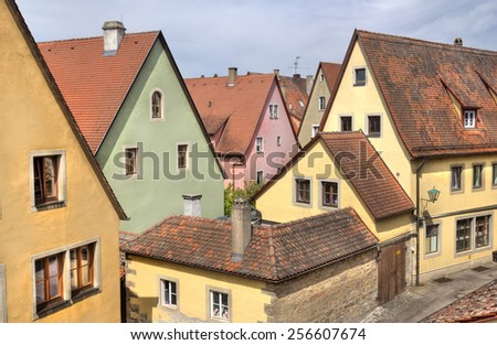 Colorful historical houses as seen from the city wall in Rothenburg ob der Tauber, Germany - stock photo