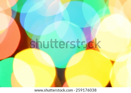 Colorful holiday background with defocused lights