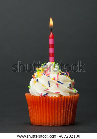 Colorful Homemade Birthday Cupcake With One Burning Candle. Copy Space - stock photo