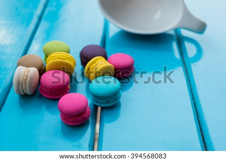 Colorful homemade macaroons on wooden