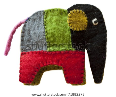 Colorful homemade toy felt elephant isolated on white background