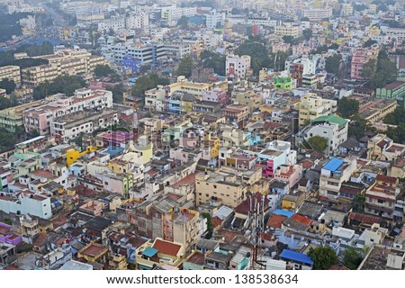 Colorful homes in crowded Indian city Trichy - stock photo