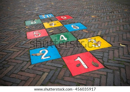 colorful hopscotch game on a public street