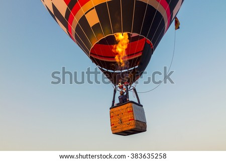 Colorful hot air balloon early in the morning in Hungary - stock photo