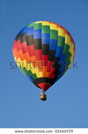 Colorful hot-air balloon floating against blue sky
