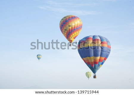 colorful hot air balloon in blue sky - stock photo