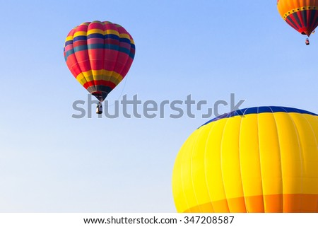 Colorful hot air balloon in the blue sky.