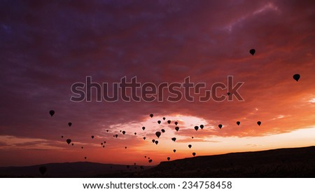 Colorful hot air balloon is flying at sunrise  - stock photo