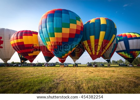Colorful Hot air balloon is starting to fly - stock photo