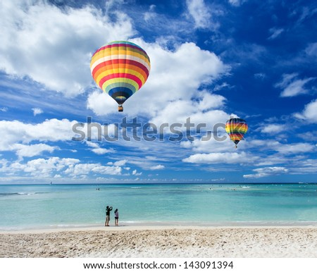 Colorful hot air balloon over Waikiki beach with blue sky background, Hawaii - stock photo