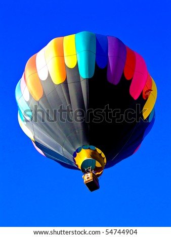 Colorful hot air balloon travelling to the sky