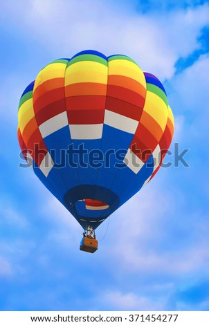 Colorful hot air balloon with cloudy sky background
