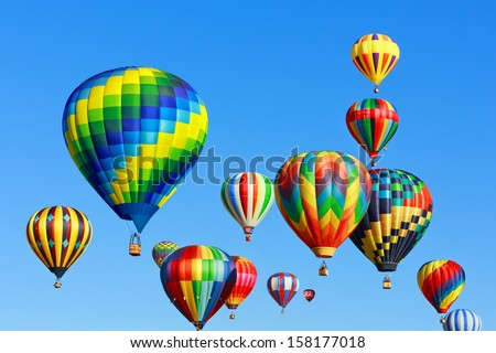 colorful hot air balloons against blue sky - stock photo