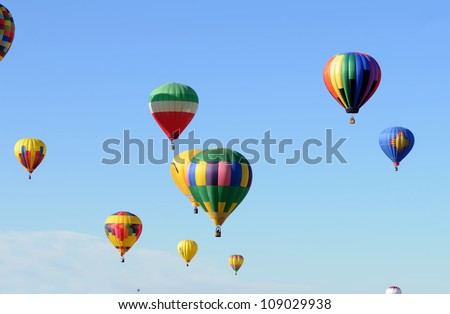 Colorful hot air balloons ascending - stock photo