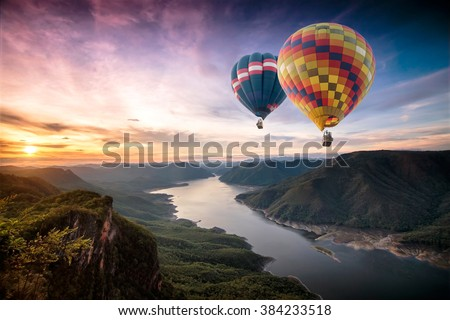 Colorful hot air balloons flying over on Mae Ping National Park at sunrise - stock photo