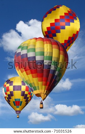 Colorful Hot Air Balloons in a Beautiful Cloudy Sky